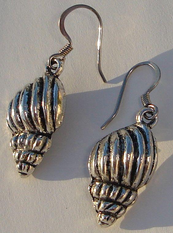 seashell metal charm pierced dangle earrings by Ziporgiabella