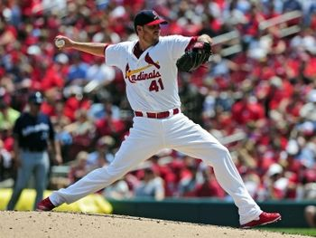 Cardinals starting pitcher John Lackey throws to a Milwaukee Brewers batter during the second inning. Cards won 3-2. 8-03-14