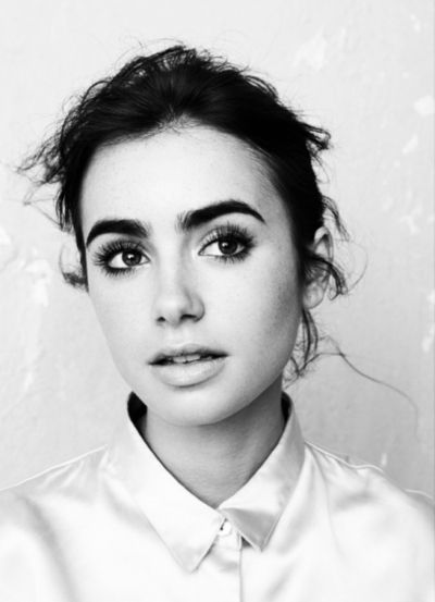 lily collins - she makes big eyebrows beautiful.