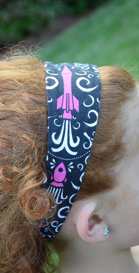 A headband that shows off her love of rockets and space!