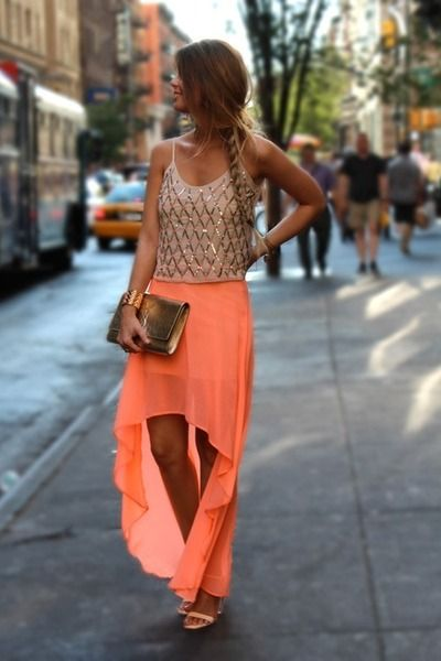 Tan shirt-orange skirt-white heels.