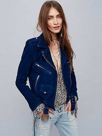Suede Western Jacket   American made suede moto jacket featuring exposed gunmetal zipper detailing throughout and snap closures. Belt at the waist features a western-inspired buckle. Lined.