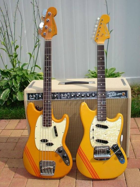 1969 Fender Mustang Competition with twin single coil pups and vibrato tailpiece, and a Mustang Bass Competition, both in beautiful Orange finish with red racing stripes, with matching painted headstock, paired with a 50th anniversary reissue of a 60s blackface Fender Twin Reverb