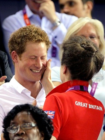 In This Photo: Prince Harry  Harry, Prince of Wales gets a playful pinch on the cheek from his aunt, Princess Anne as he cheers on Team GB while attending the track cycling events held at the Velodrome during the 2012 London Summer Olympics.  (August 7, 2012