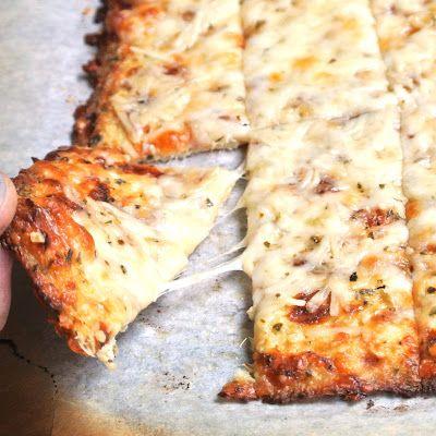 Cauliflower Breadsticks -- 1 large head of cauliflower;  2 cloves garlic, grated or minced; 2 large eggs, lightly beaten; 4 oz low fat mozzarella cheese; 1/2 tsp onion powder; salt & pepper