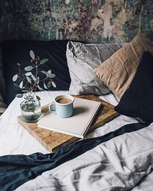 Hygge bedroom, cozy bedding with coffee: