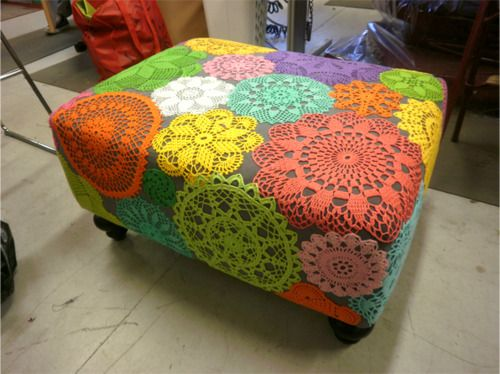 Adhere colorful crocheted doilies to a solid fabric lined ottoman. How Festive!
