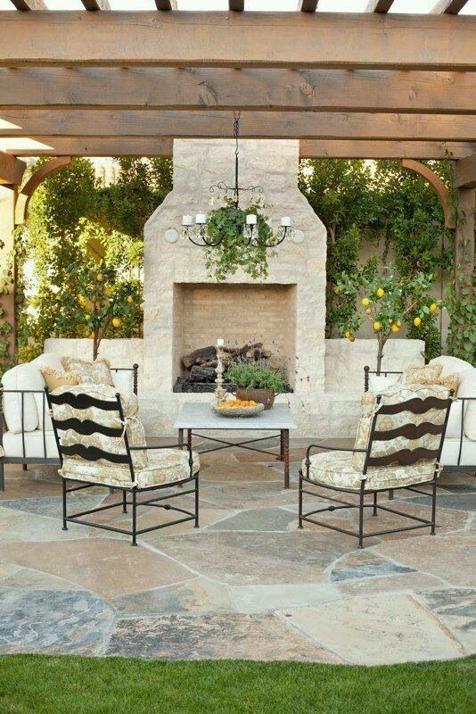 Outdoor Brick Fireplace Under A Pergola Large Flagstone Pavers Under The Patio Set And A Metal Ch Outdoor Pergola Outdoor Fireplace Designs Backyard Fireplace