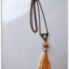 Sautoir pompon coton et perles en papier dans les tons de jaune orangé