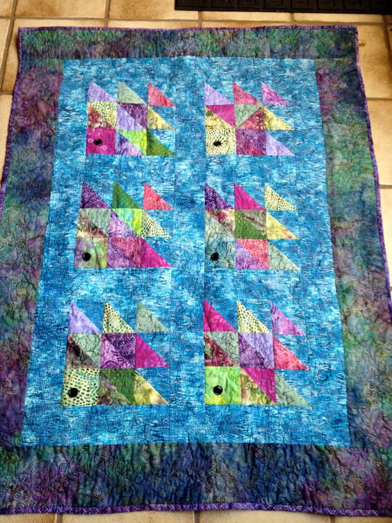Handmade fish quilt of batik fabric and by for Fish fabric for quilting