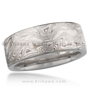 Platinum Mokume Gane Wedding Ring - This mokume gane is made up of layers of three different metals: platinum, sterling and 14k palladium white gold. This extremely low contrast mokume needs to have an etch to best accentuate the contrast of colors of the metals. Our most subtle mokume for your wedding band. If you like a rugged look, but prefer a limited color contrast, the heavy etched Platinum Mokume Gane wedding band may be just for you. You will still have the woodgrain texture, but the…