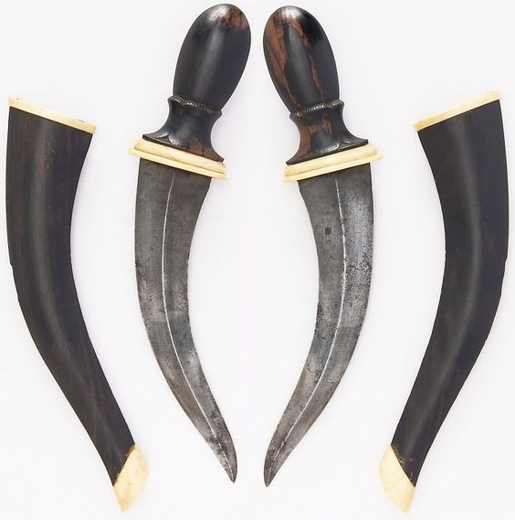 Bornean khanjar dagger, 18th to 19th century, wood, bone, steel, H. with sheath 10 1/8 in. (25.7 cm); H. without sheath 8 9/16 in. (21.7 cm); W. 1 15/16 in. (4.9 cm); Wt. 3.9 oz. (110.6 g); Wt. of sheath 1.3 oz. (36.9 g), Met Museum, Bequest of George C. Stone, 1935.