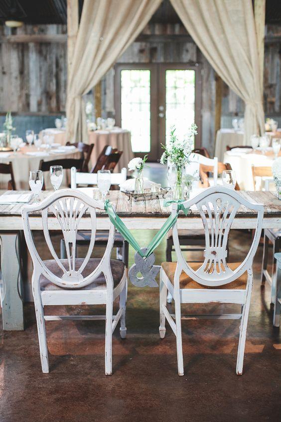 Photography: SMS Photography - smsphotography.com Venue: Vista West Ranch - 512-894-3500 - Floral by Petal Pushers - 512-894-0808 #vistawestranch #smpweddings #stylemepretty #hillcountry #hillcountryweddings #drippingsprings #austinweddings #rustic #barn #rusticbarn #weddingcapitol #texas #texasweddings #floral #&sign #andsign #mr&mrs
