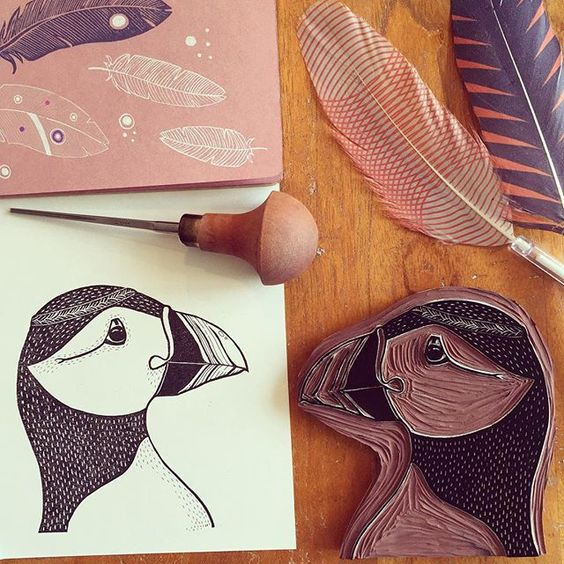 A new stamp project in progress. This time I'm making a carving out of my earlier puffin painting. I don't know if you remember, but he's got feathers on his head, so my next challenge is to carve some feathers that will fit him.