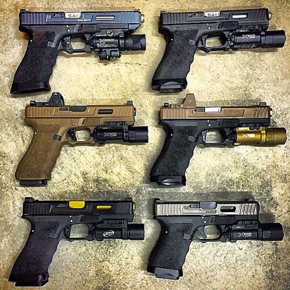Assortment of Salient Arms International Glocks with assorted SureFire lights and some with Trijicon RMRs