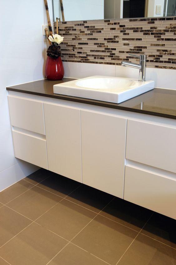 Bathroom design idea wood benches coffee coloured tile for Bathroom feature tile designs