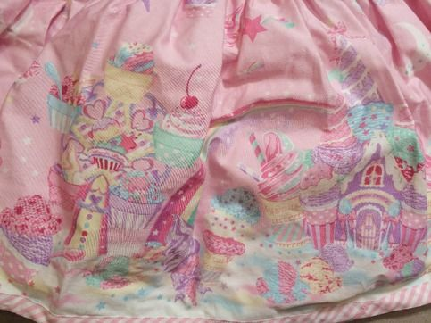 This is an adorable skirt by Angelic Pretty!  It features a carnival/sweets theme and comes with a bow on the front waist band! It also had two pockets in the front large enough for a cell phone.  This item has only been worn once and is in the same condition I received it in.  At 30 inches...