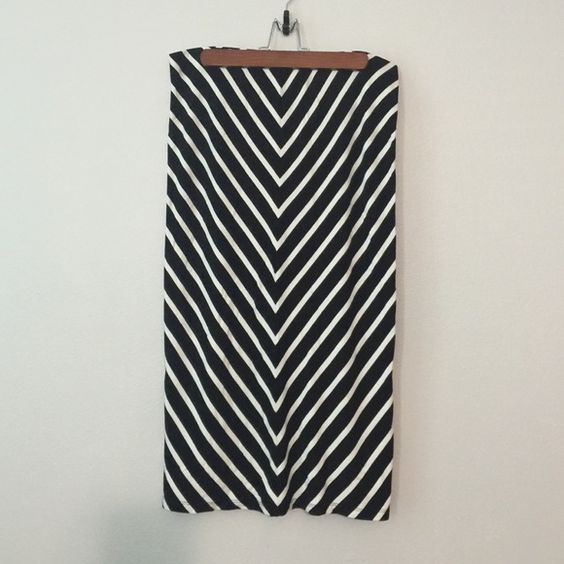 Mossimo pencil Skirt NWOT Stretchy cotton stretch blend pencil skirt. Flattering black and white stripe designs. The stripes are angled to make this skirt flattering. Super comfy stretch. MIDI length glass below knee. Skirts Midi