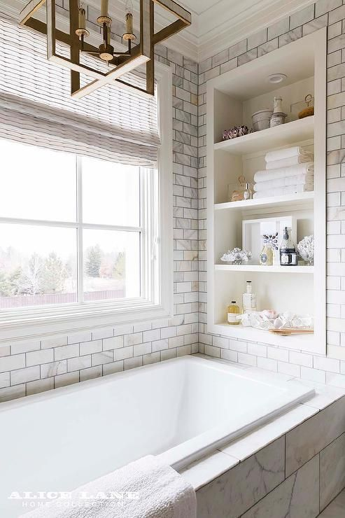 Bathtub Nook Completed With A Built In Shelf Surrounding Calcutta Gold Marble Tiles Small Bathroom Remodel Bathrooms Remodel Bathroom Design