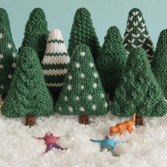 A knitting pattern for nine more Christmas trees to add to your miniature forest. They can be left as they are or decorated. They are perfect for making baubles, hanging ornaments, garlands and other decorations. The trees are knit flat and if using Cascade 220 yarn and 4mm needles are