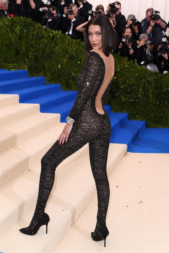 Bella Hadid is nearly naked in a sheer, beaded black Alexander Wang catsuit.