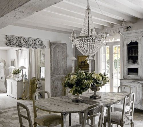 Like the scroll work over the door, wood beams and the rest of the wood painted white. The natureal light all coming in. :-)
