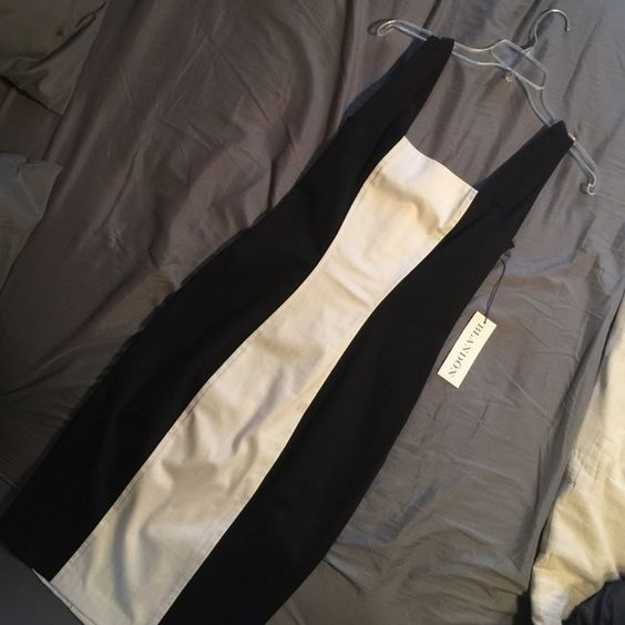Color Block: Black and White Contoured Dress Beautiful color block black and white dress. So flattering to the body. Size 4. Sleeveless. Never worn. In perfect condition from a smoke and pet free home. Blandon Dresses Strapless