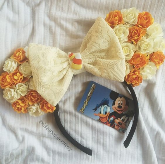 Handmade ears  Halloween/fall themed  I used creme and orange flowers and finished it off with a creme lace bow and candy corn detailing  One size fits all <3