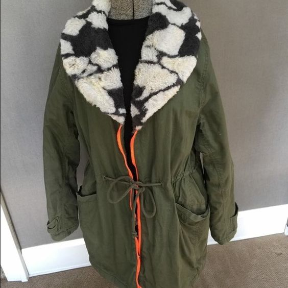 Cool army green parka faux fur collar Vera wang Really cool winter parka jacket with faux fur collar, contrasting fluorescent orange zipper, deep pockets, and split in back with ties. Princess Vera Wang. Vera Wang Jackets & Coats Puffers
