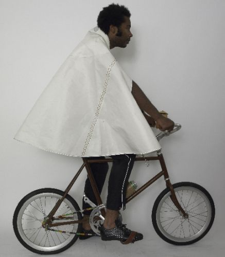 Capes made from recycled sails with inside large pockets, reflective zips and openings (all zips reversible. Reflective shock cord attachment to bars to keep cape down in wind.