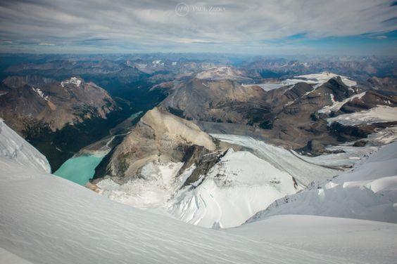 A summit view down the N Face towards Berg Lake, the Helmet and the Robson Glacier. Photo by Paul Zizka Photography.