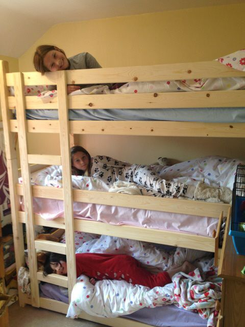 3 happy kids in there triple bunks.