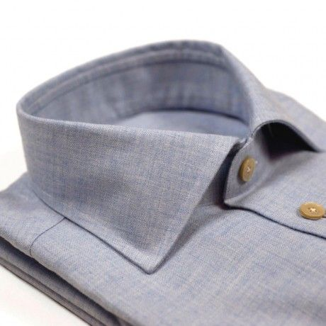 "Light blue brushed cotton/wool shirt, spread collar $235.00 A handsome shirt with the unique hand of a cotton/wool mix. It can be dressed up with a knitted tie and sport coat - or dressed down with a cardigan and a pair of chinos or jeans Alumo Lanella Jr fabric; 83% cotton, 17% wool Classic Italian spread collar - 4cm high, 8.5cm points Handsewn and shanked mother-of-pearl buttons with ""crow foot"" stitching Hand-attached sleeves, hand-sewn details on gussets Made in Ginosa, Italy:"