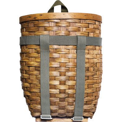 Lightweight rattan pack basket with leather handle and cotton shoulder straps, my friend had one and it worked well for a picnic.