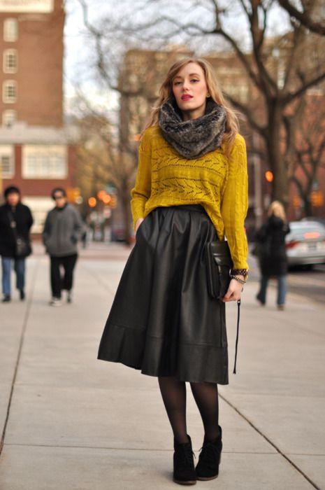 Dark grey midi skirt, yellow sweater, grey fur scarf, black tights and booties