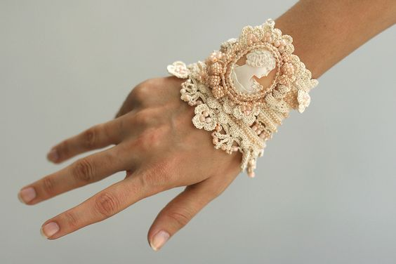 Cream crochet cuff with antique shell cameo by ellisaveta on Etsy, $108.00: