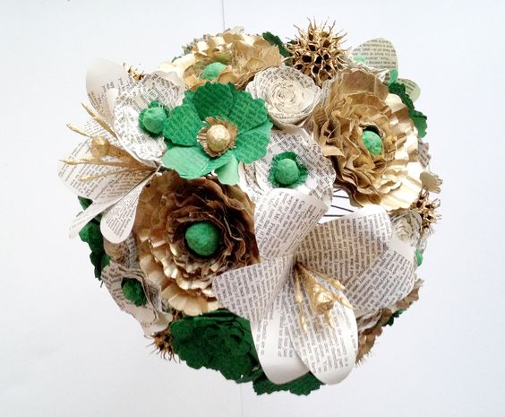 Paper bridal bouquet handmade from Jane Austen book pages. This bouquet is in off-white, gold and emerald with lilies, peonies, anemones, roses, poppies and sweet gum. Let #AnthologyOnMain make your wedding bouquet unique! Visit www.AnthologyOnMain.com to get started!