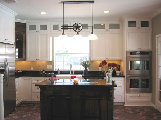 Texas Lone Star Kitchen With Custom Cabinets Stacked Upper Cabinets With Glass Doors And