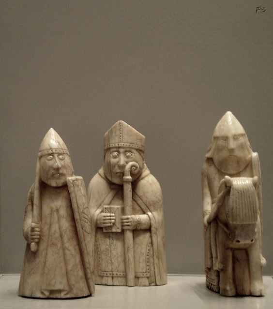Three chess pieces from an original batch of 92 found near Uig, Isle of Lewis, Scotland, some time before 1831. They were hand carved from walrus ivory or whales teeth and they are most probably Norwegian, used by Vikings to kill time before a raid and another. Seen at British Museum, London.