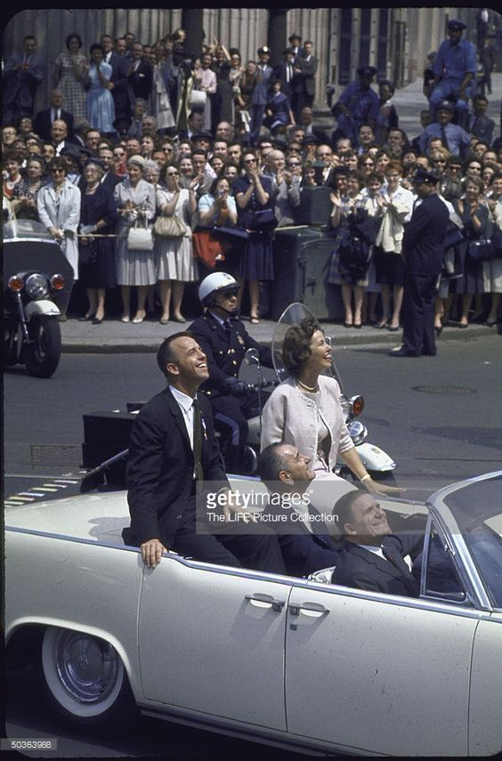 Astronaut Alan Shepard and wife riding in celebratory motorcade with Vice President Lyndon Johnson (seated, center, back seat) after his successful sub-orbital space flight aboard Freedom 7.