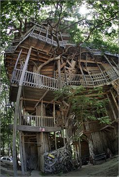 World's Largest Tree House Stands 10-Stories Tall ~ The treehouse built by Horace Burgess rises 97 feet into the sky, the support provided by a live, 80-foot-tall white oak 12 feet in diameter at its base. Six other trees brace the tower-like fortress, but Burgess says its foundation is in God.
