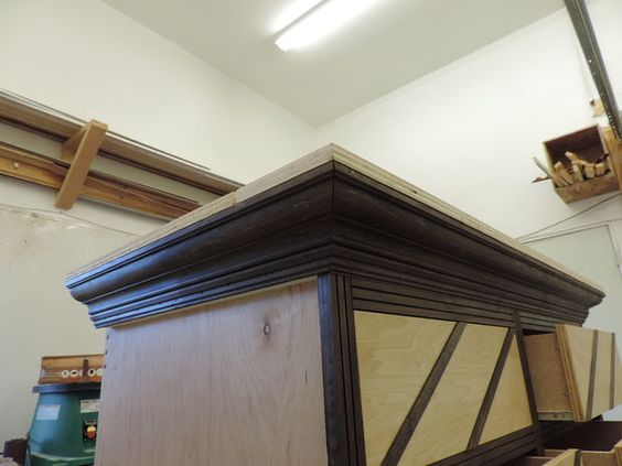 Picture of Putting the frame (carcass/box) of the dresser together. notice the lumber shelves on the wall.  Do this