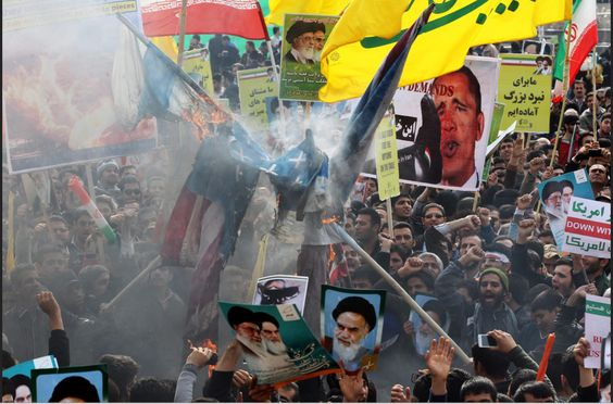 IRANIAN MUSLIMS SHOUT DEATH TO AMERICA ON ANNIVERSARY OF JIMMY CARTER HELPING TO PUT ISLAMIC CLERICS INTO POWER.
