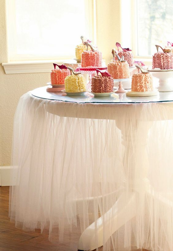 Idea: Use tulle as skirt around dessert table. Love this. We are going to have our reception in a villa at Hamilton Cove at Catalina Island, so I have no idea how the villa itself will look like, and this is a neat idea to make the reception a little nicer!
