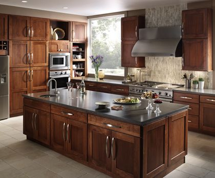 Fieldstone milan cherry nutmeg center island quartz for Kitchen center island cabinets