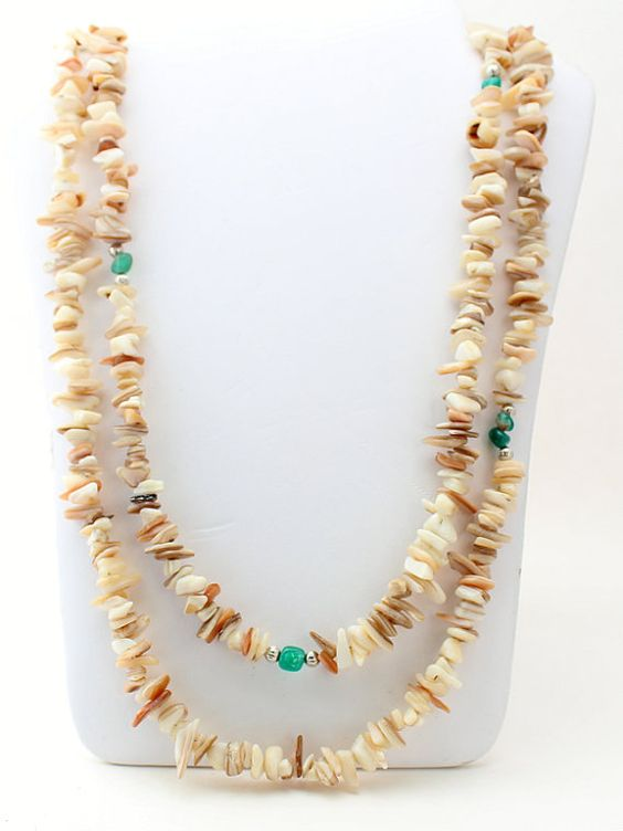 Beautiful, long, 2-strand necklace that features natural Mother of Pearl shell and splashes of green agate.    Necklace: 33 long