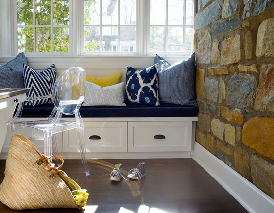 Charming built in window seat with drawer storage in a breakfast room with stone wall. Blue and White Classic Decor Inspiration: Ella Scott Design. #blueandwhite #classicdecor #interiordesignideas #interiordesigninspiration #traditionalstyle #banquette #ghostchair #blueandwhite