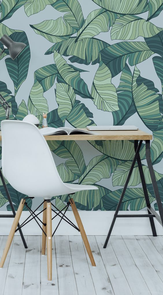 Using green in your work spaces can help to relieve stress and create a calming environment. This blue and green tropical wallpaper design is both stylish and soothing.:
