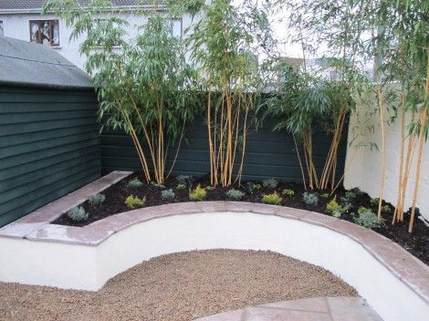 Rendered concrete block raised bed with sandstone wall for Rendered garden wall designs