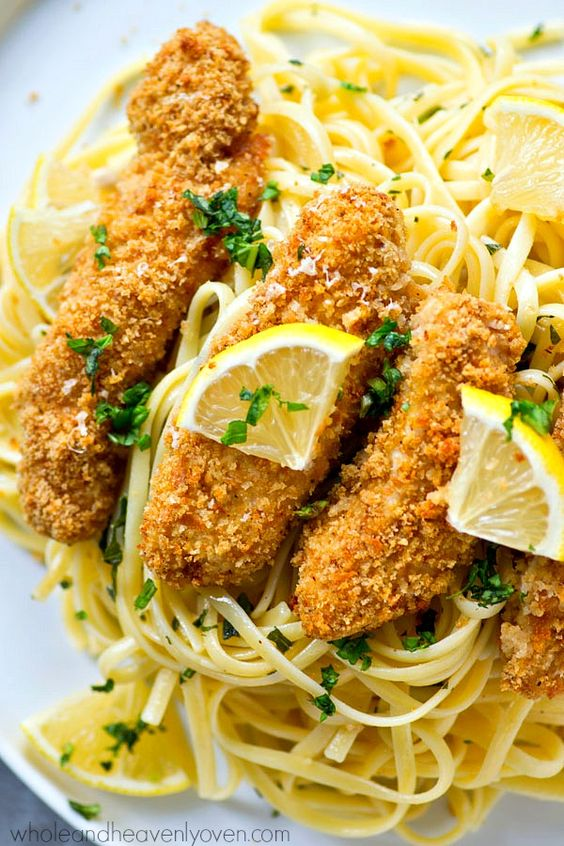 Crispy lemon Parmesan baked chicken strips and buttery herb noodles ...